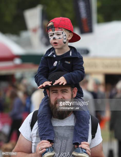 A young fan with his face painted on his fathers shoulders during Day Four of The Land Rover Burghley Horse Trials 2017 on September 2 2017 in...