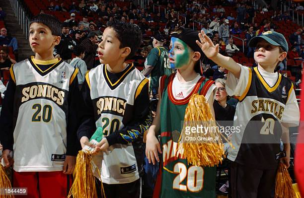 Young fans at the game between the Milwaukee Bucks and the Seattle Sonics during the game at Key Arena on February 21, 2003 in Seattle, Washington....