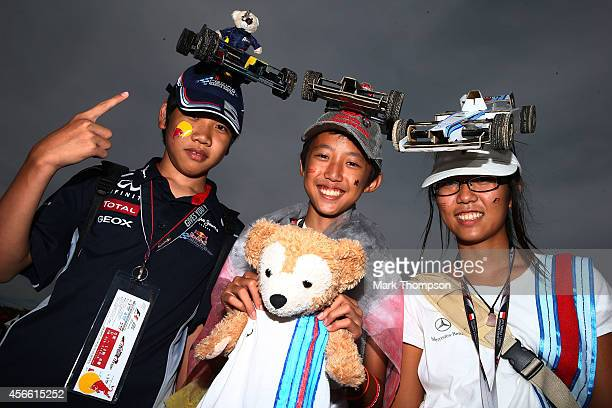Young fans attend Qualifying for the Japanese Formula One Grand Prix at Suzuka Circuit on October 4 2014 in Suzuka Japan
