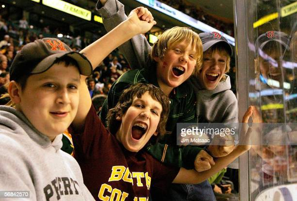 Young fans cheer after a goal during the championship game of the 54th annual Beanpot tournament between the Boston College Eagles and the Boston...