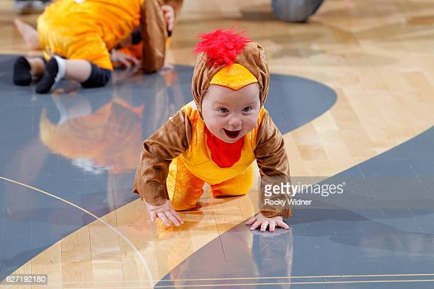Young fans dressed as turkeys race during the game between the Oklahoma City Thunder and Sacramento Kings on November 23 2016 at Golden 1 Center in...