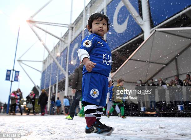 Young fans enjoy the pre match atmosphere outside the stadium prior to the Premier League match between Leicester City and Manchester City at the...