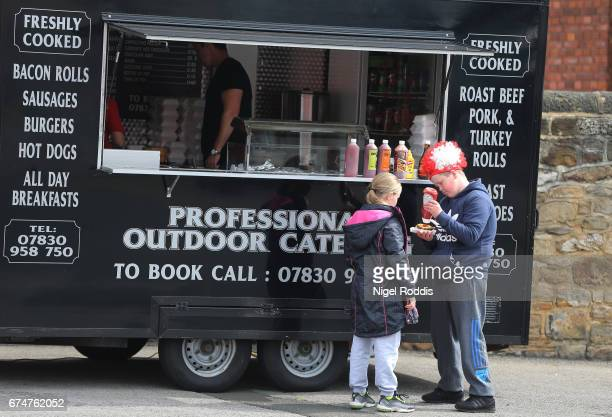 Young fans grab a bite to eat prior to the Premier League match between Sunderland and AFC Bournemouth at the Stadium of Light on April 29 2017 in...