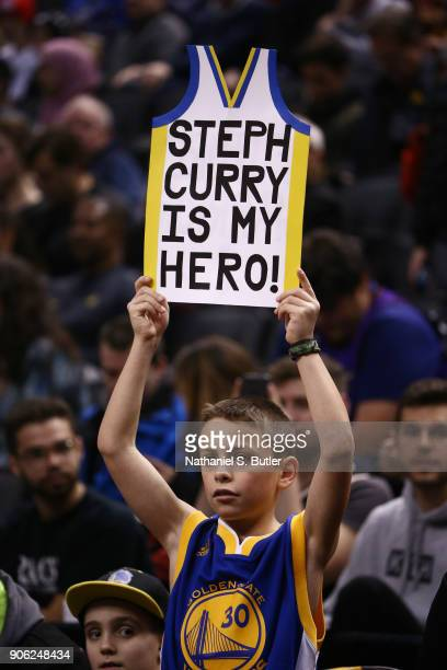 young fans hold a sign during the game between the Golden State Warriors and Toronto Raptors on January 13 2018 at the Air Canada Centre in Toronto...