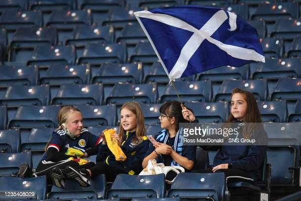 Young fans in the stands ahead of kick off during a FIFA World Cup Qualifier between Scotland and Faroe Islands at Hampden Park on September 21 in...