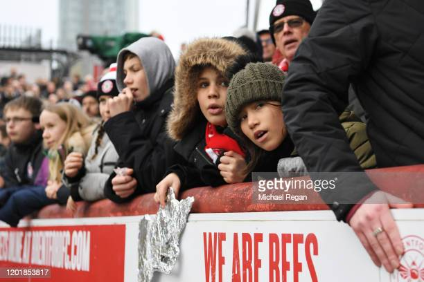 Young fans look on during the FA Cup Fourth Round match between Brentford FC and Leicester City at Griffin Park on January 25 2020 in Brentford...