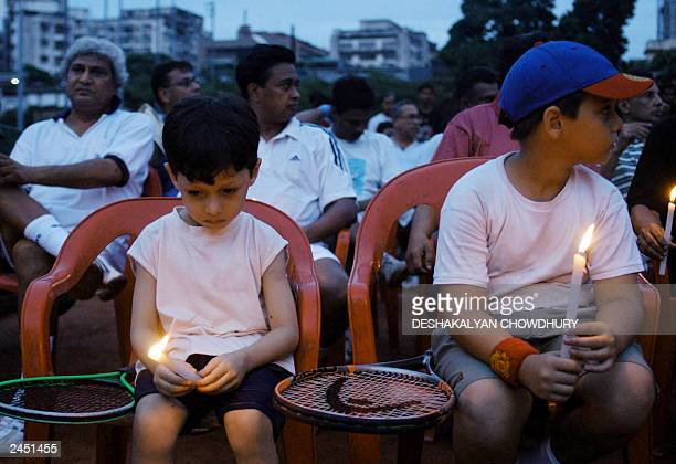 Young fans of Indian tennis player Leander Paes hold candles as they join older tennis enthusiasts in wishing for the speedy recovery of Paes during...