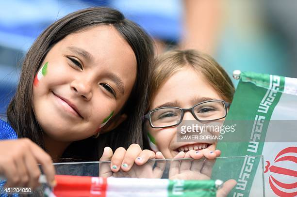 Young fans of Iran smile before a Group F football match between BosniaHercegovina and Iran at the Fonte Nova Arena in Salvador during the 2014 FIFA...