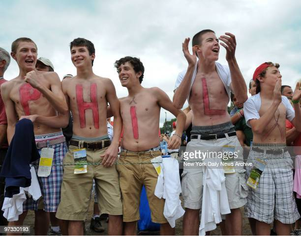 Young fans of Phil Mickelson have his name and a pink ribbon on their chests on the 16th hole of the final round of the US Open golf championship on...