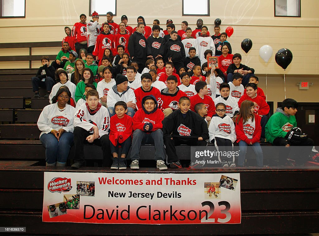 Young fans of the New Jersey Devils pose for a photo during the Hockey in Newark instructional clinic on February 13, 2013 in Newark, New Jersey.