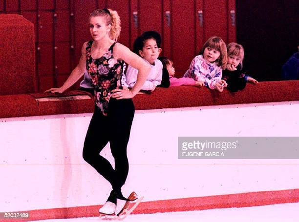 Young fans of US figure skater Tonya Harding look on while she takes a break from training at the Clackamas Town Center mall rink 24 January 1994 as...