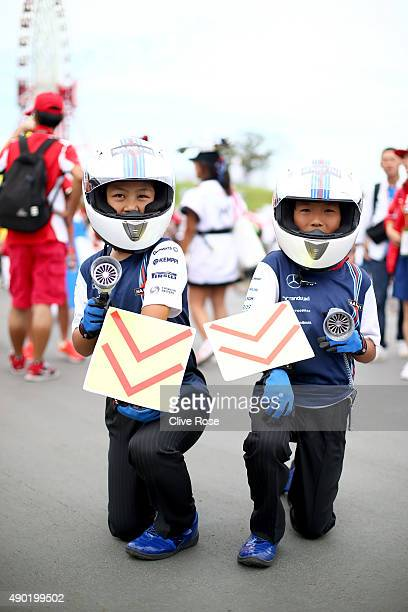 Young fans of Williams F1 pose outside the circuit before the Formula One Grand Prix of Japan at Suzuka Circuit on September 27 2015 in Suzuka Japan