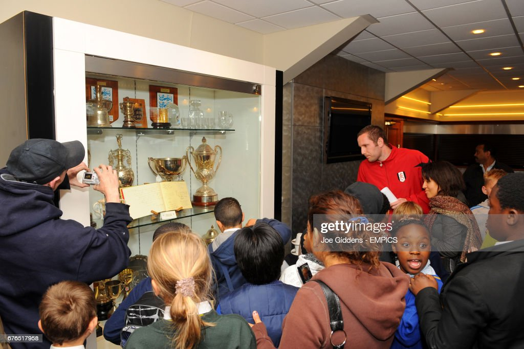 Young Fans On A Tour Of The Trophy Room At Craven Cottage