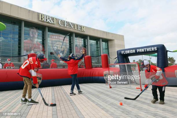 Young fans play hockey outside the arena prior to the game between the Florida Panthers and the Tampa Bay Lightning in Game One of the First Round of...