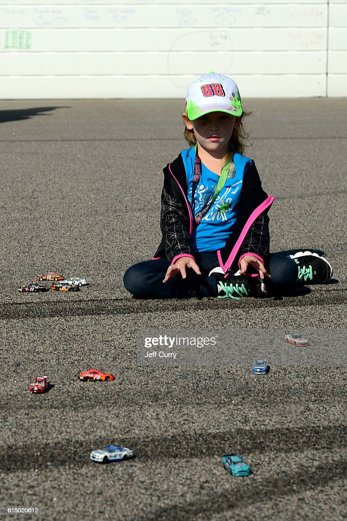 Young fans play on the track prior to the NASCAR Sprint Cup Series Hollywood Casino 400 at Kansas Speedway on October 16, 2016 in Kansas City, Kansas.