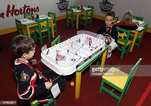 Young fans play table hockey during the NHL Fan Fair at the Ottawa Convention Centre on January 27 2012 in Ottawa Ontario Canada
