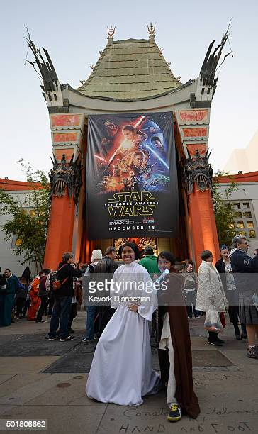 Young fans pose in front of the TCL Chinese Theatre before the opening night of Walt Disney Pictures and Lucasfilm's Star Wars The Force Awakens at...