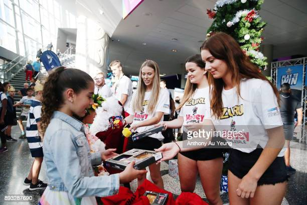 Young fans receiving Christmas gifts on arrival prior to the round 10 NBL match between the New Zealand Breakers and the Adelaide 36ers at Spark...