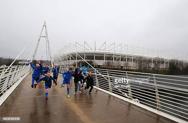 Young fans run outside the ground the Barclays Premier League match between Swansea City and Aston Villa at Liberty Stadium on December 26 2014 in...