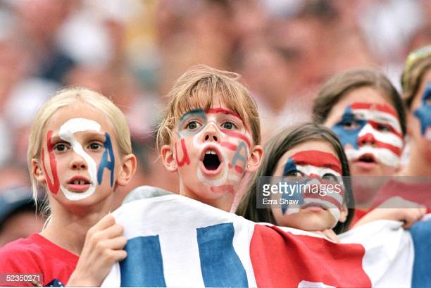 Young fans show their support during the 1999 Women's World Cup match between Team USA and Team Germany on July 1 1999 at RFK Stadium in Washington...