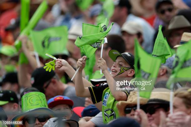 Young fans show their support during the Big Bash League match between the Sydney Thunder and the Adelaide Strikers at Spotless Stadium on January 13...