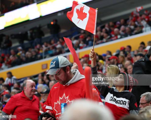 A young fans shows support for Team Canada during the Gold medal game against Sweden of the IIHF World Junior Championship at KeyBank Center on...