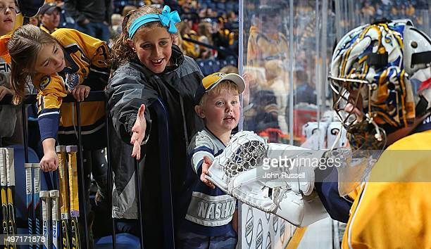 Young fans tap the glove of Marek Mazanec of the Nashville Predators after warmups against the Winnipeg Jets during an NHL game at Bridgestone Arena...