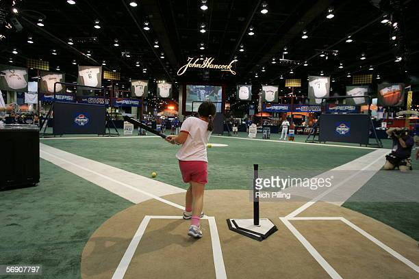 Young fans try out the T-ball field at the John Hancock Major League Baseball All-Star Fan Fest at the COBO Center on July 9, 2005 in Detroit,...