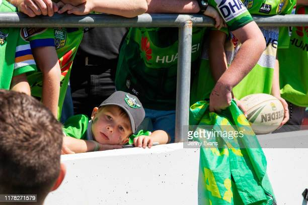 Young fans wait for the players to sign autographs after a Canberra Raiders Training Session & Media Opportunity at GIO Stadium on October 01, 2019...