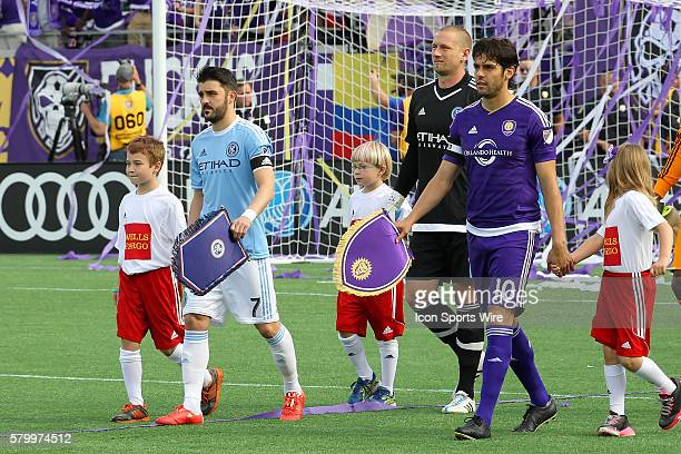 Young fans walk onto the pitch with David Villa and Josh Saunders of New York City FC and Kaka of Orlando City SC before the MLS game between the New...