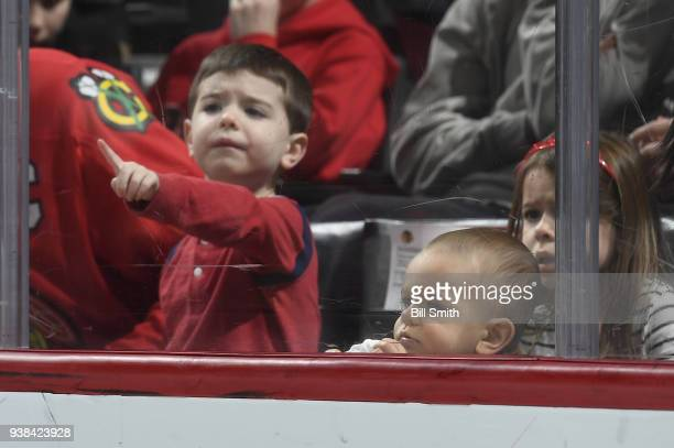 Young fans watch the game between the Chicago Blackhawks and the San Jose Sharks at the United Center on March 26 2018 in Chicago Illinois