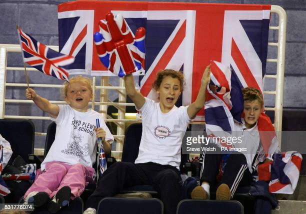 Young fans watch the match between Great Britain's Greg Rusedski and Serbia Montenegro's Janko Tipsarevic during the first day of the Davis Cup at...