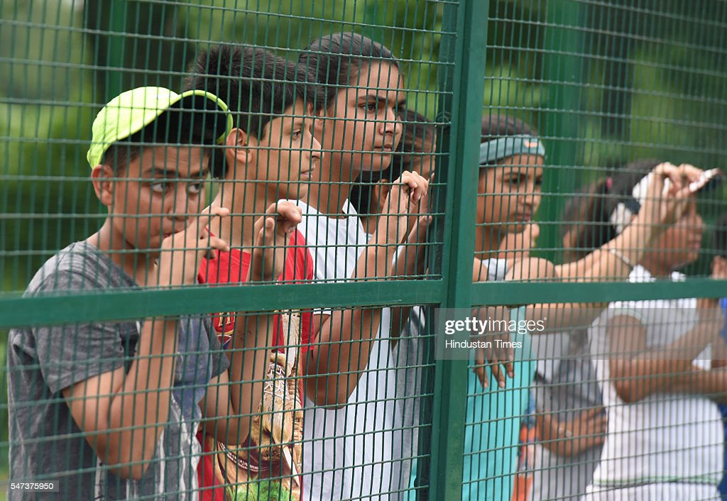 Young fans watching the Devis Cup practice session at Chandigarh Club on July 14 2016 in Chandigarh India