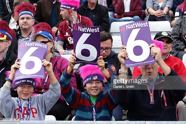 Young fans wave their six cards during the NatWest T20 Blast Finals day at Edgbaston on August 20 2016 in Birmingham England