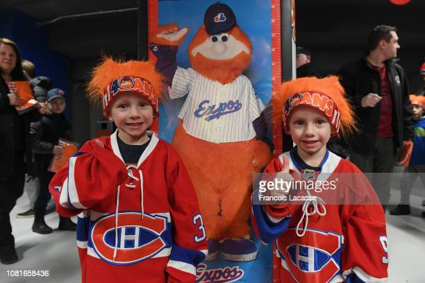 Young fans wear an orange hairpiece to celebrate Montreal Canadiens mascot Youppi 40th birthday prior to the NHL game between the Montreal Canadiens...