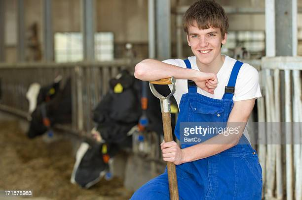 young farmer at stable - part time job stock pictures, royalty-free photos & images