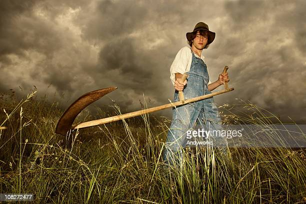 young farmer at work - scythe stock photos and pictures