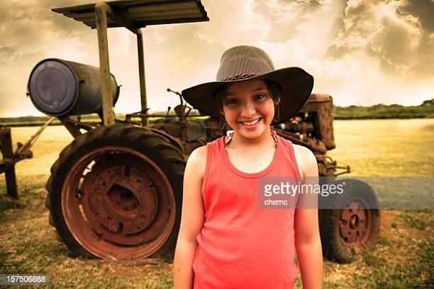 young farmer girl and tractor