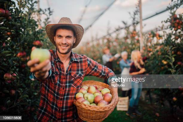 Young farmer holding an apple