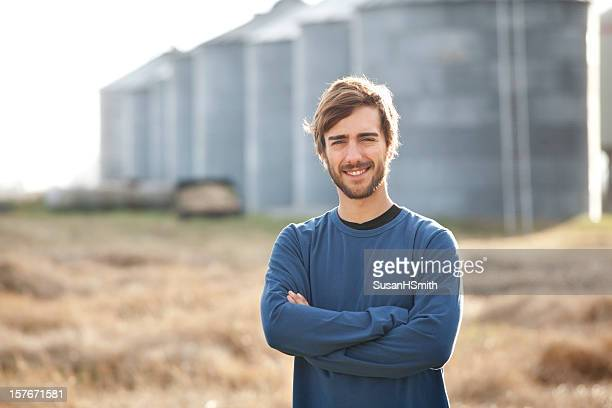 young farmer with grain bins - karl lagerfield bildbanksfoton och bilder