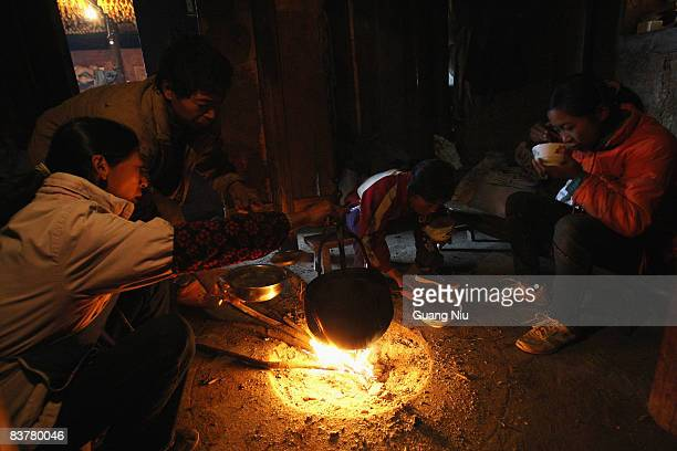 A young farmer's family eat breakfast in their home in the village of Gulucan on November 17 2008 in Hanyuan county Sichuan province China More than...