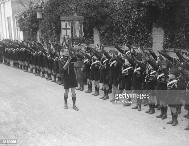 Young Fascists in black uniforms are to give a display of Italy's youth under arms to the British Prime Minister Neville Chamberlain and the Foreign...