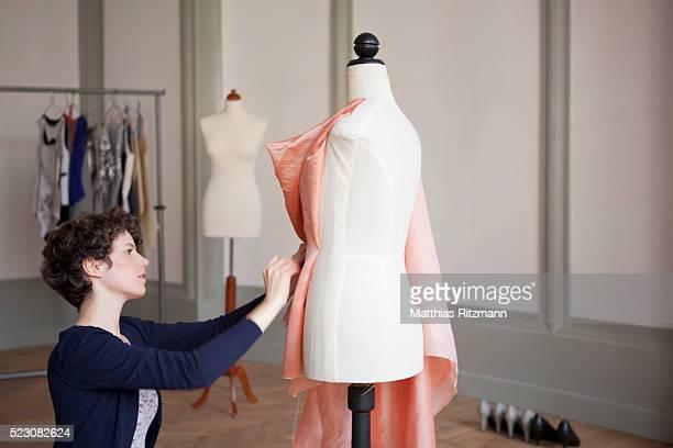 Young fashion designer at work