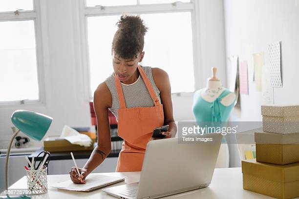 young fashion designer in home office - fashion designer stock photos and pictures