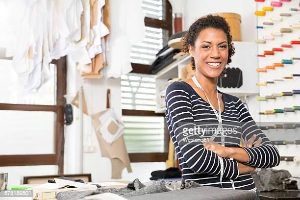 Young fashion designer in workshop