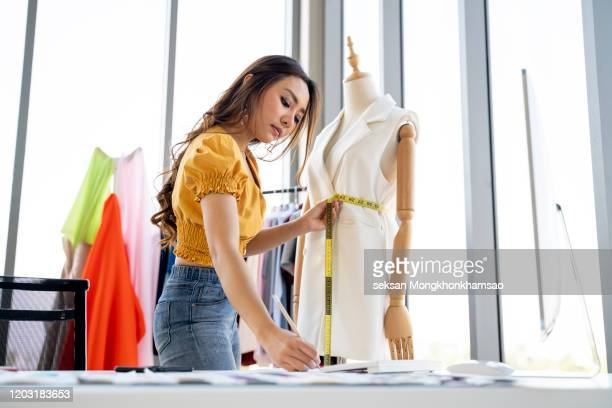 young fashion designer working in her atelier - fashion designer stock pictures, royalty-free photos & images