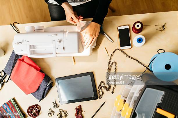 Young fashion designer working in her studio