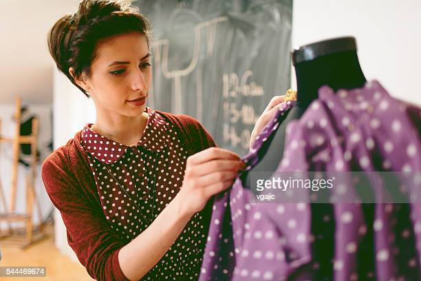 Young Fashion Designer Working In Her Workshop
