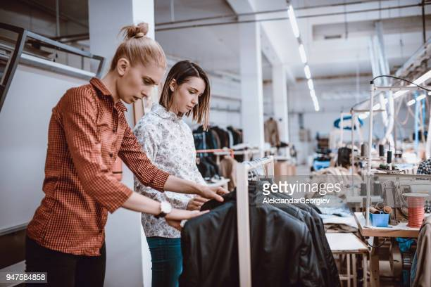 young fashion designers doing quality control in textile factory - textile factory stock photos and pictures