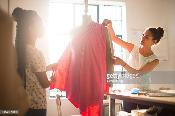 Young fashion designers in their studio